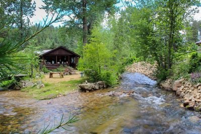 Our large cabin from the children's garden looking across the creek.