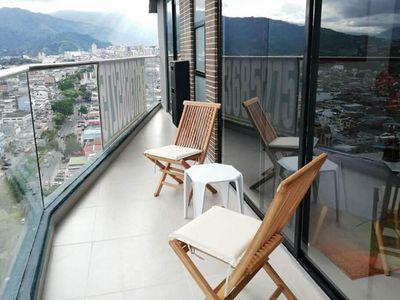Photo for Apartment with pool and a stunning city view!