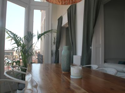 Photo for Amazing apartment with stunning city views in central Barcelona