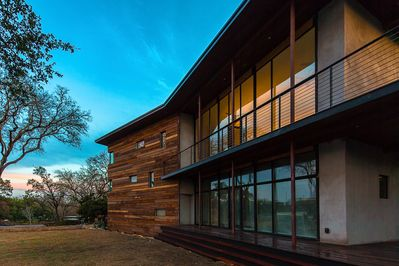 Warm wood meets modern architecture, with lots of outdoor space to enjoy nature