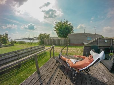 Photo for 4 pers. Holiday home with lake view in front of the Lauwersmeer