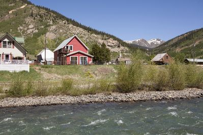 The house sits on the clear water of the Animas River.