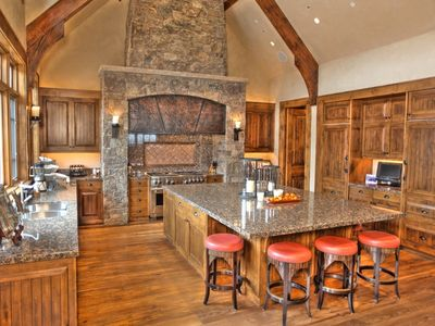 Kitchen with additional sitting room & TV plus deck with views of Aspen Mountain