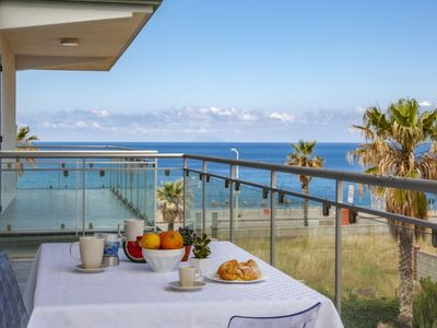 Photo for Cobalto - 2-bedroom apartment  with large lateral sea view terrace and pool in the garden