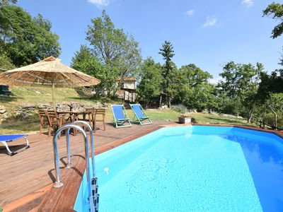 Photo for Rustico farmhouse with garden and swimming pool in a hilly area