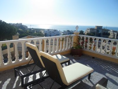 Photo for Town house with shared pool and stunning roof terrace, close to the beach