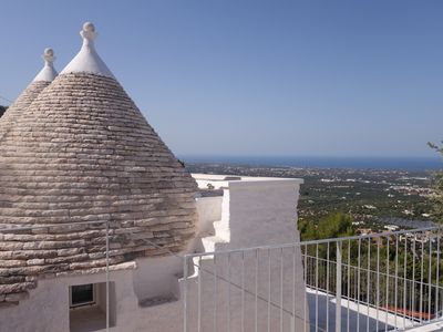 Photo for LUXURIOUS TRULLO SLEEPS 4 WITH PANORAMIC SEA VIEW IN FASHIONABLE HOLIDAY AREA