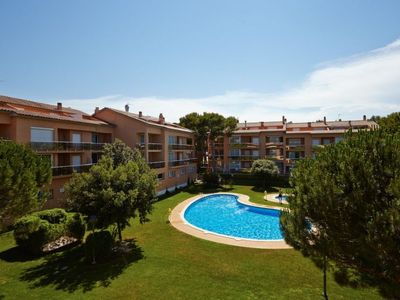 Photo for 4 bedroom Apartment, sleeps 8 with Pool, FREE WiFi and Walk to Beach & Shops