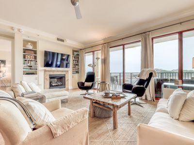 Photo for Stunning gulf-front condo w/ beach access & resort pools/hot tubs/gym!