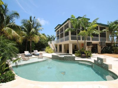 Photo for Beachy-Keen Large Pool home steps From Sombrero Beach