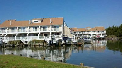 Photo for FREE DAILY ACTIVITIES!!! BRING YOUR BOAT!!! Outdoor Pool!  Crab Cove is a three-level, canalfront townhome located on the bayside