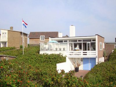 Photo for Attractive apartment surrounded by rugosa rose shrubs, near the dunes and the coast