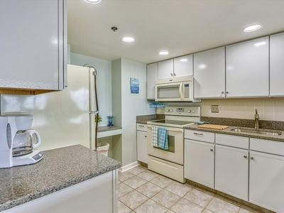 Photo for FREE DAILY ACTIVITIES! Direct Oceanfront 2 - bedroom, 2 - bath with den unit