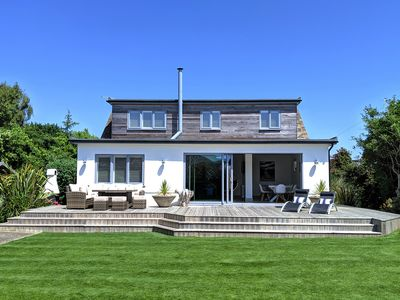 Photo for Luxury seaside home with beautiful south facing garden on private sea estate