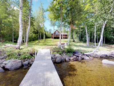 Photo for Beautiful lakefront cabin w/dock, jetted tub, firepit, full kitchen