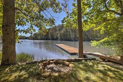 Head out back to the 50-foot floating dock and stone fire pit.