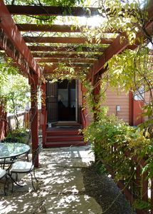 Looking into the back door of the Chalet from under the shady pergola.  Come in!