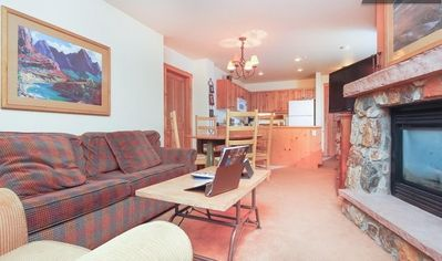 Cozy up on the comfortable pull-out sofa in front of gas fireplace and HDTV.