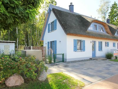Photo for Holiday house Stranddistel - House: 90m², 3-room, 4 pers., Terrace, garden