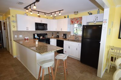 Spacious, fully stocket kitchen with granite counter tops