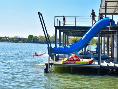 Photo for HEATED Pool, Hot Tub, Two-Story Boat Dock w/ Waterslide, 8,500 lb Boat Lift!