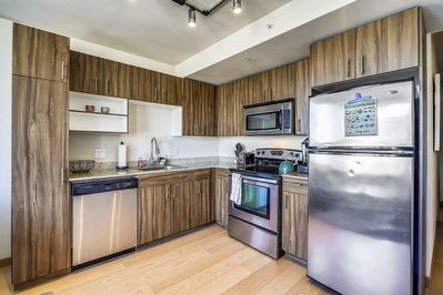 Open Kitchen with Stainless Appliances and Custom Soft Touch Cabinets