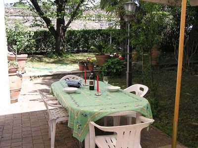 Photo for Central Sansepolcro spacious Garden Apartment in Front of Ancient Walls