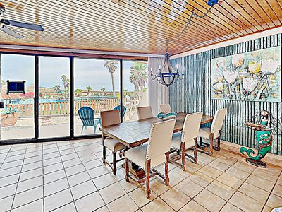 Photo for Stylish Condo w/ Pools & Hot Tub - Just steps to the Beach