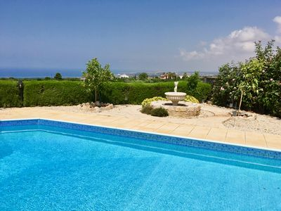 Panoramic view from pool area, with fountain and fruit trees