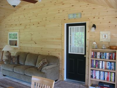 Sunroom has Plenty of Room for Watching TV, Playing Games or Doing Puzzles!
