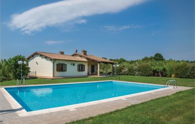 Photo for Holiday house with terrace, garden and pool on a hillside