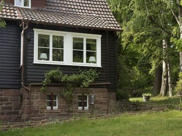 Cosy wooden house in the English style