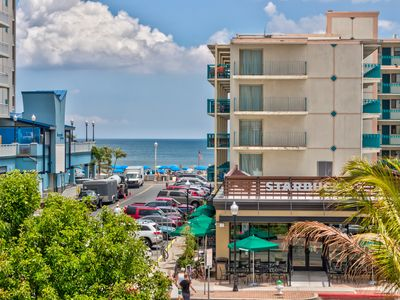 Photo for Peek-a-boo oceanview condo w/ shared pool & prime location 1 block from beach!