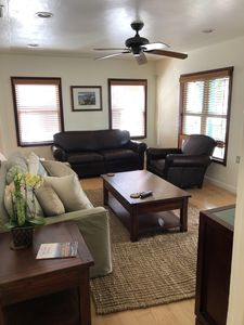 Living room with extra pullout leather sofa (Full size) and chair