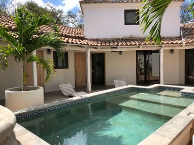 Photo for Casa Cartagena - 30 second walk to the Beach - Golf Cart Included
