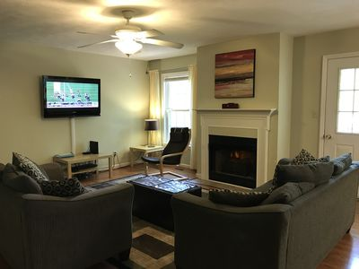 First floor living room with cozy sofas; 46in TV