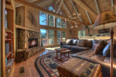 Living area with large sectional sofa facing stone fireplace and VIEWS!