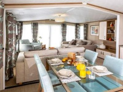 Photo for Selsey Sussex 5 star Holiday New Platinum 8 Berth Caravan with Glass Veranda