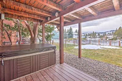 This waterfront home features a private hot tub, private dock and spacious deck!