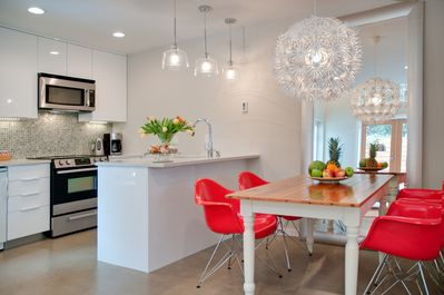 Open kitchen dining area with a mix of eclectic furnishings