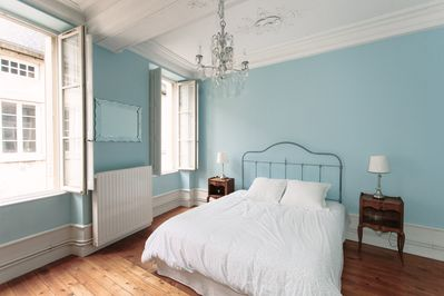 "The ""blue"" bedroom with a queen-sized bed, huge armoire, desk, and chair."