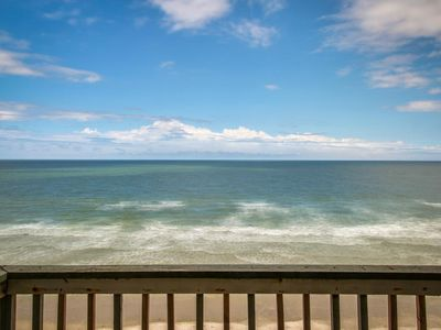 Photo for Dog-friendly oceanfront condo w/ ocean views & beach access - snowbirds welcome!