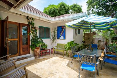 Spacious private back patio with Umbrella table and chairs