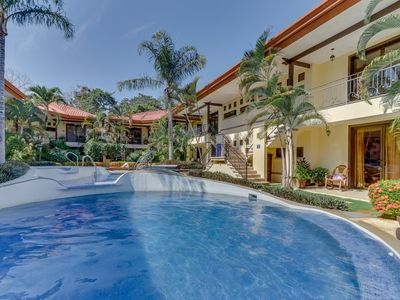 Photo for Spacious condo w/ a shared outdoor pool  & gated entrance - near the beach