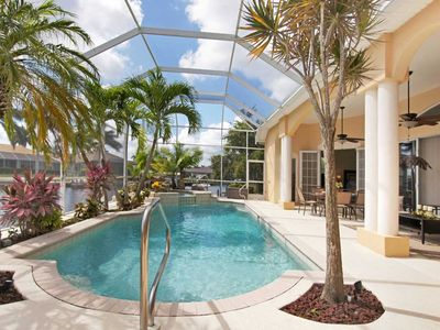 Photo for 32% OFF! -SWFL Rentals - Villa Leigh - Relaxing 4 BR Home with Tropical Lanai on Gulf Access Canal