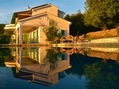 Villa Loukia early morning light with mirror reflection on the pool