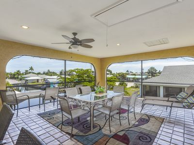 Photo for NEW LISTING! Spacious duplex-style condo w/enclosed patio & water views
