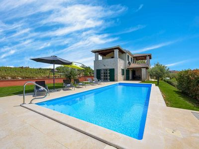 Photo for Panoramic view from a beatiful villa with swimming pool in Kaštelir