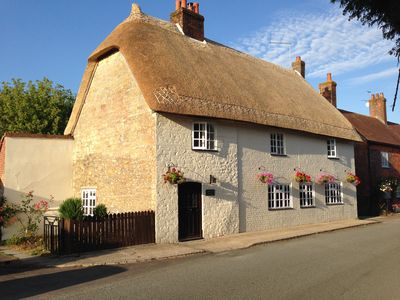 Photo for A Unique and Characterful 17th Century Thatched Cottage.