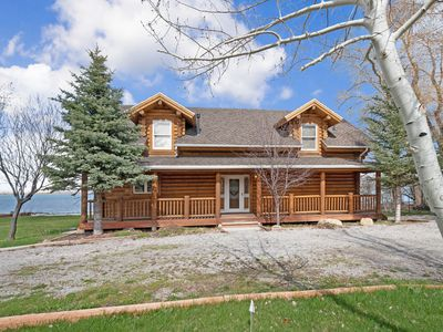 Photo for Large, waterfront cabin w/ a pool table, furnished deck, & landscaped yard